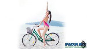 กวางเดอะเฟสออกมาโชว์ผิวขาวๆ บนรถจักรยานริมชายทะเล